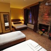 FAMILY-ROOM-1-180x180 Hotel