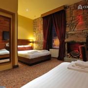 FAMILY-ROOM-3-180x180 Hotel