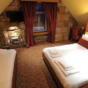 FAMILY-ROOM-4-180x180 Hotel